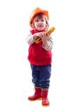 Niño en el casco de protección con las herramientas Foto de archivo