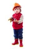 Niño en el casco de protección con las herramientas Imágenes de archivo libres de regalías