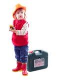 Niño en el casco de protección con las herramientas de funcionamiento Imagen de archivo libre de regalías