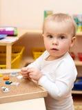 Niño en el cuarto de niños Imágenes de archivo libres de regalías