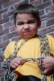 Niño en el encadenamiento Fotografía de archivo libre de regalías
