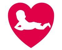Niño en el medio de un corazón Foto de archivo libre de regalías