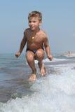 Niño en el movimiento Fotografía de archivo libre de regalías
