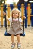 Niño en el oscilación Fotografía de archivo