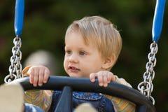 Niño en el oscilación Fotos de archivo libres de regalías
