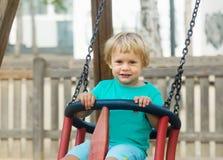 Niño en el oscilación Fotografía de archivo libre de regalías