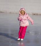 Niño en el patinaje de hielo rosado Imágenes de archivo libres de regalías