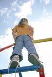 Niño en el poste que sube 04 Imagen de archivo