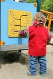 Niño en el tablero de la actividad Foto de archivo libre de regalías