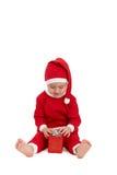 Niño en el traje de santa con el presente Imágenes de archivo libres de regalías