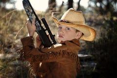 Niño en equipo del vaquero Fotografía de archivo