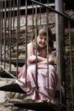 Niño en escalera espiral Foto de archivo libre de regalías