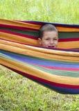 Niño en hamaca Foto de archivo