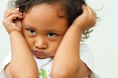 Niño en humor irritable imagen de archivo