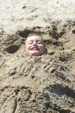 Niño en la arena Imagenes de archivo
