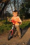 Niño en la bici Foto de archivo libre de regalías