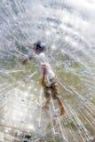 Niño en la bola de Zorbing imagen de archivo