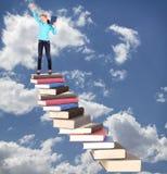 Niño en la escalera de libros Imágenes de archivo libres de regalías