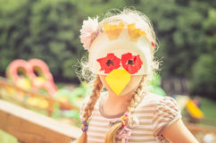 Niño en la máscara animal del papel Imagen de archivo libre de regalías
