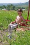 Niño en los round-robins Fotos de archivo