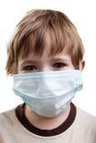 Niño en máscara de la medicina Imagen de archivo libre de regalías