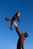 Niño en mid-air Fotos de archivo