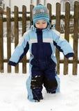 Niño en nieve Fotos de archivo
