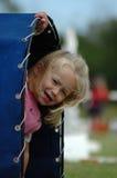 Niño en patio Imagenes de archivo