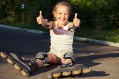 Niño en pcteres de ruedas Foto de archivo libre de regalías