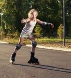 Niño en pcteres de ruedas Imagen de archivo libre de regalías