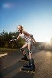 Niño en pcteres de ruedas en el verano Fotografía de archivo libre de regalías