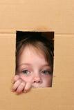 Niño en rectángulo Fotos de archivo
