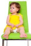 Niño en silla fotografía de archivo