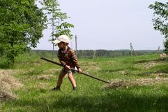 Niño en trabajo Imagen de archivo libre de regalías