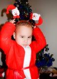 Niño en trajes de la Navidad Foto de archivo