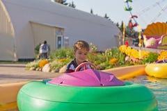 Niño en un barco inflable Fotografía de archivo libre de regalías