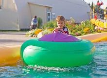 Niño en un barco inflable Imágenes de archivo libres de regalías