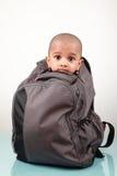 Niño en un bolso Imágenes de archivo libres de regalías