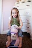 Niño en un caballo de oscilación Fotografía de archivo libre de regalías