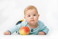 Niño en un fondo blanco imagen de archivo libre de regalías