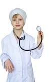 Niño en un traje médico blanco Foto de archivo