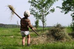 Niño en una aldea Imagen de archivo