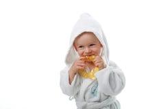 Niño en una bata Fotografía de archivo libre de regalías