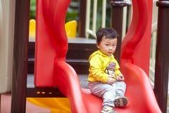 Niño en una diapositiva Fotografía de archivo libre de regalías