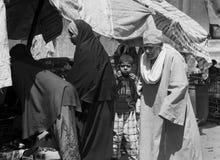 Niño en una muchedumbre Fotos de archivo