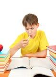 Niño enfermo con libros Imagen de archivo