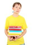 Niño enfermo con libros Fotografía de archivo libre de regalías