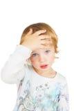 Niño enfermo o confuso. imagen de archivo