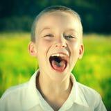Niño feliz al aire libre Imagenes de archivo