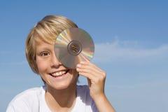 Niño feliz con Cd o dvd Foto de archivo libre de regalías